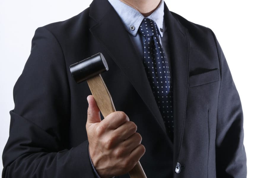 businessman-with-hammer